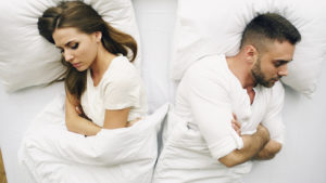 Two expectant parents wake up with nausea