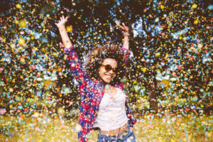 Lady smiling in a storm of confetti