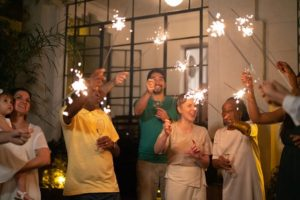 Gathering of family members celebrating a holiday with sparklers